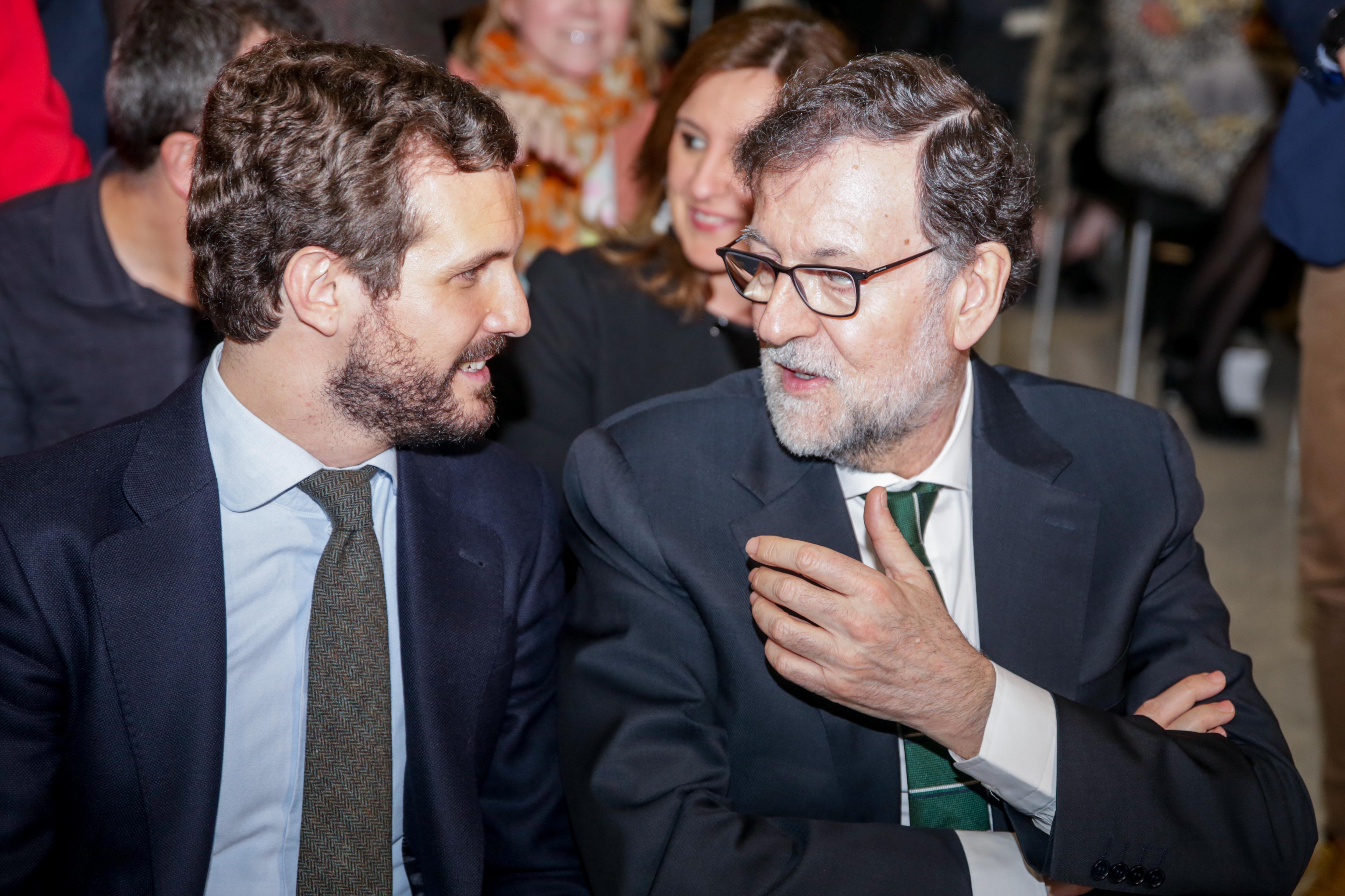 El presidente del Partido Popular, Pablo Casado; y el expresidente del Gobierno, Mariano Rajoy